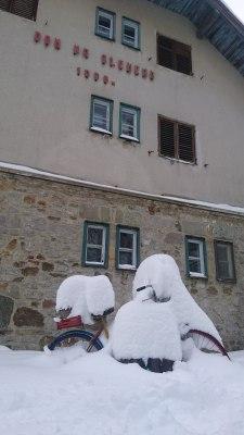 Dom na Slemenu and their snow covered bike