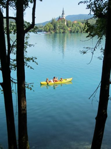 Yellow Canoe on blue Bled